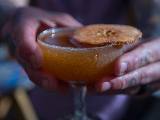 "The ""I Can't Even,"" an apple and pumpkin-infused cocktail, is one of several unique offerings from Nice Guys."