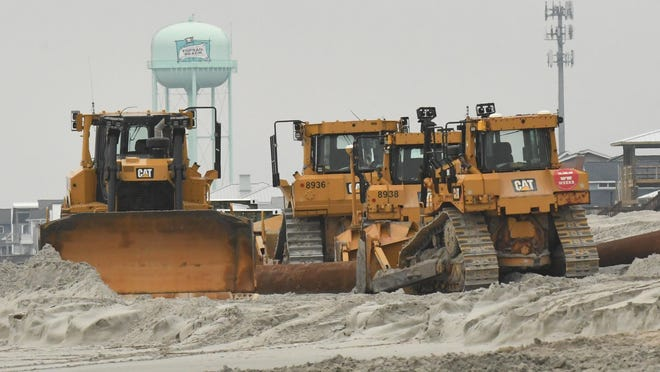 Crews work on a beach nourishment project near the Queens Grant area of Topsail Beach in March. Topsail Beach was given money from the state and FEMA to help the efforts.