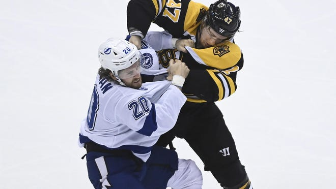 Lightning forward Blake Coleman battles Bruins defenseman Torey Krug during a round-robin game Aug. 5 in Toronto. Tampa Bay has added several players since last year to help them play a grittier game.