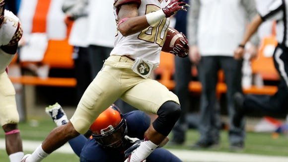 Florida State receiver Rashad Greene sprints past a Syracuse defender in Saturday's win against the Orange.