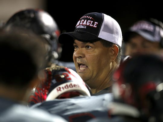 Wakulla head coach Scott Klees talks to his team during a timeout in their playoff game against Rickards. Wakulla went on to the Class 5A state title game. Klees has been named the 2015 All-Big Bend Coach of the Year.