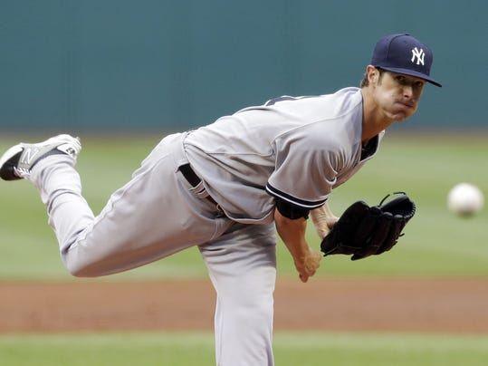 New York Yankees starting pitcher Shane Greene delivers in the first inning of a baseball game against the Cleveland Indians, Monday, July 7, 2014, in Cleveland. (AP Photo/Tony Dejak)