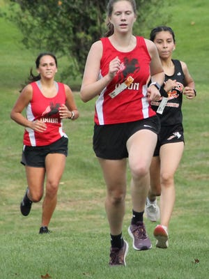 Kewanee's Melissa Fragoso gives chase to Orion's Lily Moen on Thursday at Baker Park.
