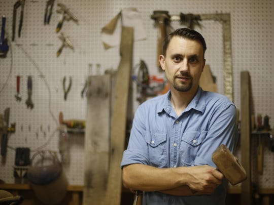 Barry Miller, owner of Rose Boulevard custom wood furniture, stands in his shop on Sept. 9.