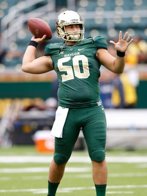 Oct 11, 2014; Waco, TX, USA; Baylor Bears long snapper Jimmy Landes warms up before the game against the TCU Horned Frogs at McLane Stadium.