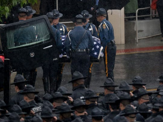 The body of  fallen Delaware State Police Cpl. Stephen