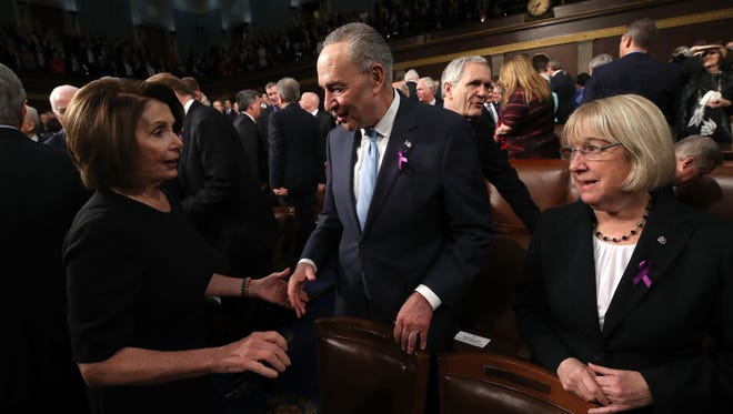Senate Minority Leader Senator Chuck Schumer (D-NY) and Senator Patty Murray (D-WA) wear purple ribbons to raise awareness for opioid abuse before the State of the Union address on Tuesday evening.