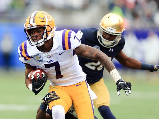 LSU Tigers wide receiver D.J. Chark (7) runs up field past Notre Dame Fighting Irish cornerback Shaun Crawford (20) during the first half in the 2018 Citrus Bowl at Camping World Stadium.