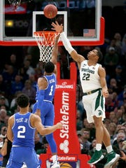 MSU's Miles Bridges blocks the shot of Duke's Trevon Duval earlier this season.