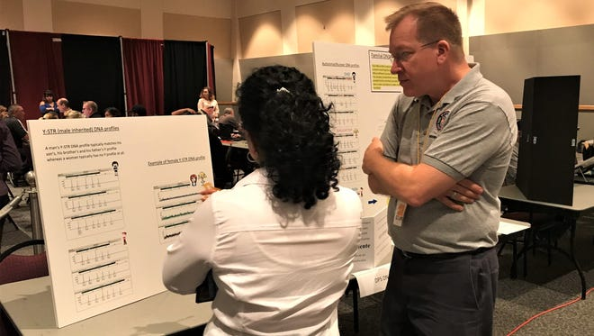 Forensic scientist Dan Merena explains to people in attendance at the third annual Missing in Arizona Day how DNA testing can help find their loved ones.