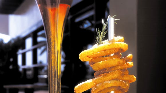Yard House Onion rings and the half yard of beer.