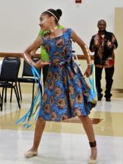 Rolena James entertains the audience with a Congolese at the annual Taste of Congo held at West Jackson Baptist Church on July 15, 2017 in Jackson, Tenn.