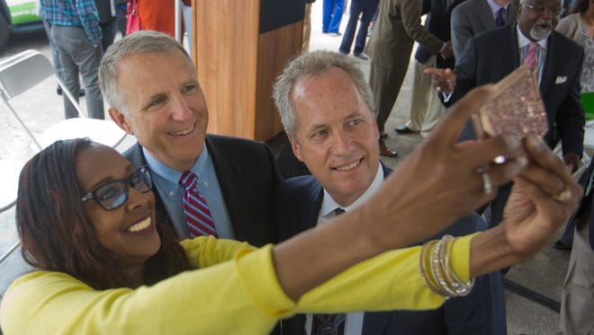 Cassandra Gray took a selfie photo with Mark B. Carter, center, and Mayor Greg Fischer after Passport Health Plans announced that they would be building their headquarters at 18th and Broadway. Carter is the CEO of the company. April 19, 2017.