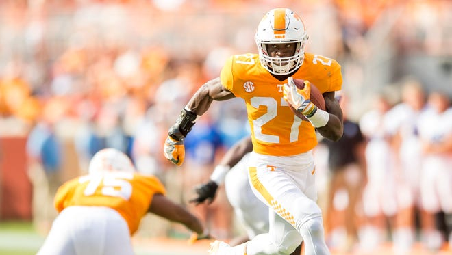 Tennessee running back Carlin Fils-aime (27) runs in for a touchdown during Tennessee's game against Indiana State in Neyland Stadium on Saturday, Sept. 9, 2017.