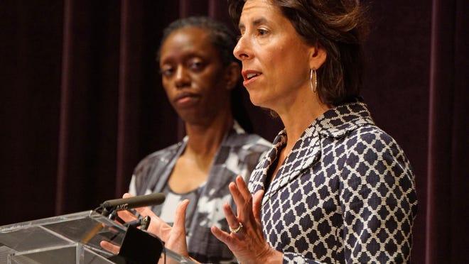 Gov. Gina Raimondo conducts Wednesday's coronavirus briefing at Veterans Memorial Auditorium in Providence, with state Health Director Dr. Nicole Alexander-Scott at left.