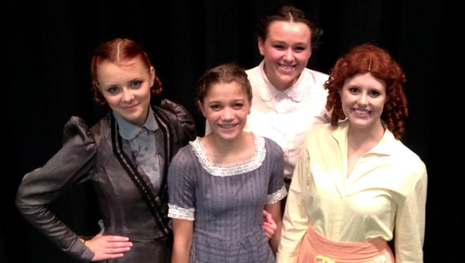 "Andrea Omernik (Jo March), Laura Mitch (Amy March), Carleen Baron (Meg March) and Clara Schanck (Beth March) play the March sisters in The Playhouse Theatre Group of Central Wisconsin's production of ""Little Women the Musical."""
