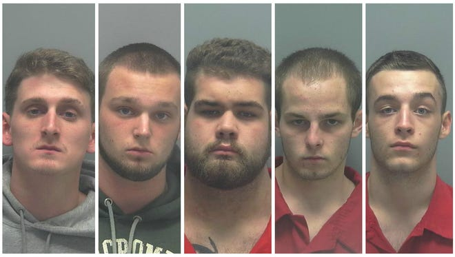 From left to right: Samuel Jones, Jacob Kluch, Christian Tezekjian, Kelly Wells and Kegan Boyle were arrested by the Lee County Sheriff's Office.
