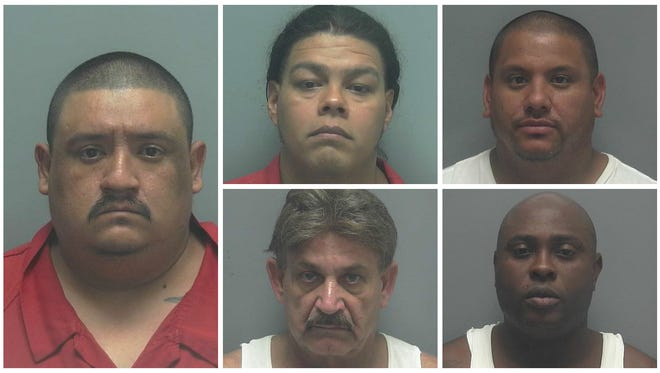 Among the seven individuals arrested on drug trafficking charges in Thursday's 'Taqueria Takedown' were from left, Enrique Nino-Gomez, Eric Nino-Nunez, Marcos Deems, Hector Lopez and Sean McCann.