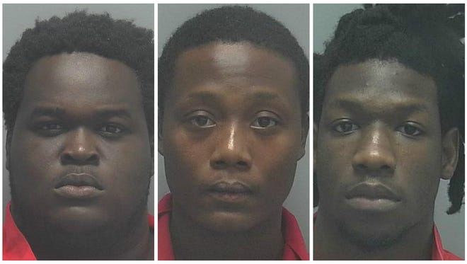 Derrick Church, 19, left, Tajze Battle, 22, and Demetrius O'Neal, 22, were arrested during a forced stop near Club Blu on Monday, July 25, 2016. All three have been named persons of interest but charges against them stem from the forced stop.