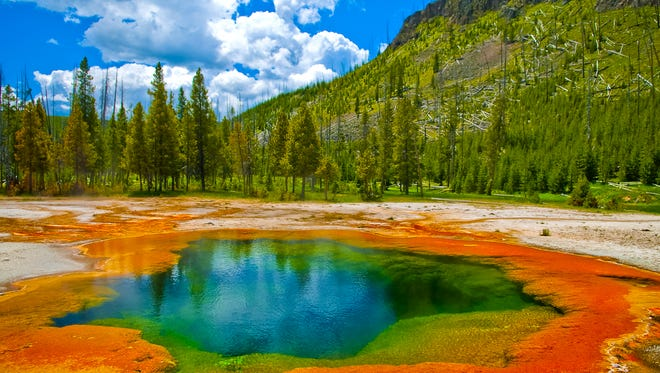 """Yellowstone National Park: It's hard not to be impressed by all of the incredible natural wonders the world's first national park has to offer. Because an active volcano lies beneath Yellowstone National Park, the site has more than 10,000 hydrothermal features such as mudpots, hot springs and geysers — including the famous """"Old Faithful."""" Plus, there are nearly 300 waterfalls and an incredible array of wildlife — including elk, moose, bison and bears — in this 3,472-square-mile park that straddles Wyoming, Montana and Idaho.  Although there are some hidden expenses to watch out for when visiting, it costs only $30 for a seven-day vehicle pass ($50 if you include a pass to nearby Grand Teton National Park). There are a few times during the year when entrance fees to all national parks are waived, however. And currently all fourth graders can visit national parks for free as part of the Every Kid in a Park program, making it a great family vacation idea."""