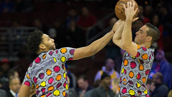 Dec 16, 2016; Philadelphia, PA, USA; Philadelphia 76ers center Jahlil Okafor (L) and guard T.J. McConnell (R) wear shirts honoring Craig Sager during warms ups before action against the Los Angeles Lakers at Wells Fargo Center. The Los Angeles Lakers won 100-89. Mandatory Credit: Bill Streicher-USA TODAY Sports ORG XMIT: USATSI-324148 ORIG FILE ID:  20161216_lbm_bs4_270.JPG
