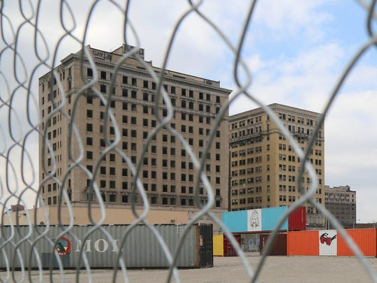 The Hotel Park Avenue building and the Eddystone can be seen beyond the fence and storage containers on Saturday, Nov. 15, 2014.