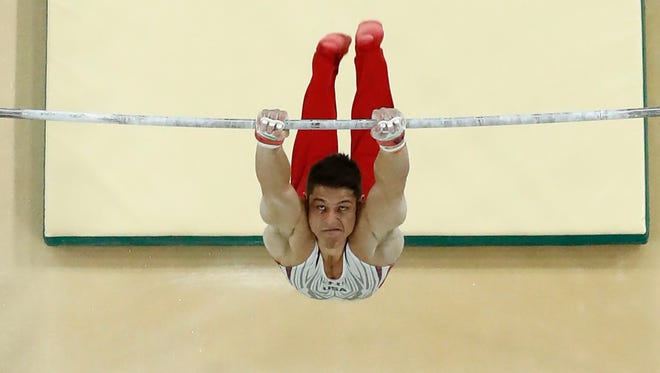 United States' Chris Brooks performs on the horizontal bar during the artistic gymnastics men's individual all-around final at the 2016 Summer Olympics in Rio de Janeiro, Brazil, Wednesday, Aug. 10, 2016. (AP Photo/Morry Gash)