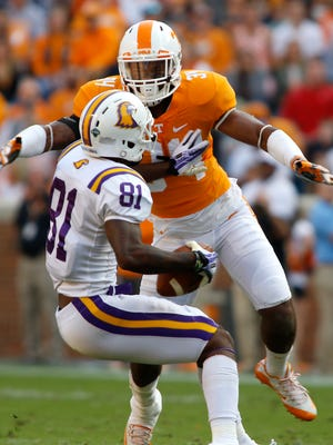Tennessee's Darrin Kirkland Jr. (34) goes for a tackle against Tennessee Tech's Austin Hicks (81) on Nov. 5, 2016.