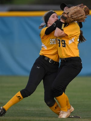 Scotts Hill teammates Chelsey Gore and Shayla Phillips (99) collide while going for a ball against Jackson Christian at Jackson Christian's Warner Taylor Field in Jackson, Tenn., on Tuesday, April 18, 2017. Gore made the catch for an out but was injured on the play.