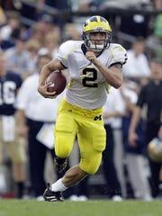 Michigan's Sam McGuffie runs for yardage against Notre