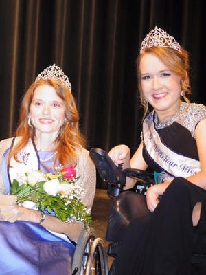 Southern Miss graduate LisaAnn Redd, left, was crowned Ms. Wheelchair Mississippi 2016 during the annual pageant. Pictured with her is last year's winner, Lauren Compere.