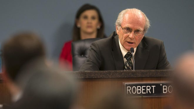 Bob Burns of the Arizona Corporation Commission speaks during a 2013 hearing.