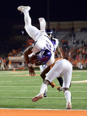 TCU quarterback Trevone Boykin (2) dives into the end zone over Texas cornerback Duke Thomas. The Horned Frogs routed the Longhorns 48-10.