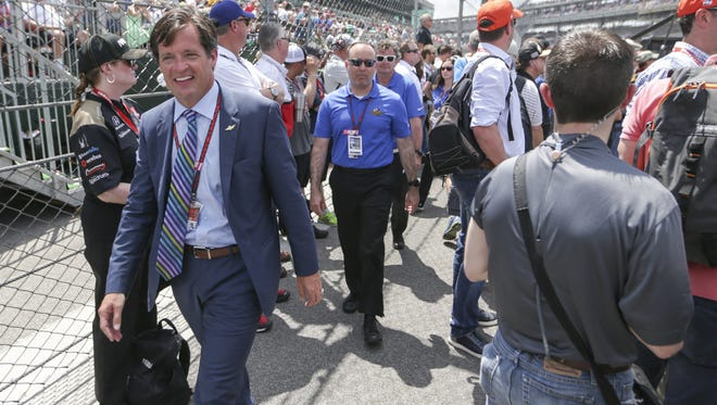 Doug Boles walks the pits during the 100th running of the Indianapolis 500, Sunday, May 29, 2016.