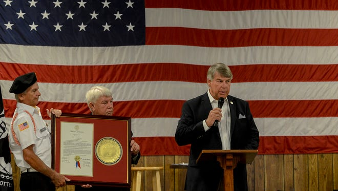 State Senator Ed Jackson gives remarks after presenting a plaque to the Veterans of Foreign Wars 6496 during the Vietnam Veterans Memorial Bridge renaming program, Tuesday, July 31, 2018, at the VFW 6496.