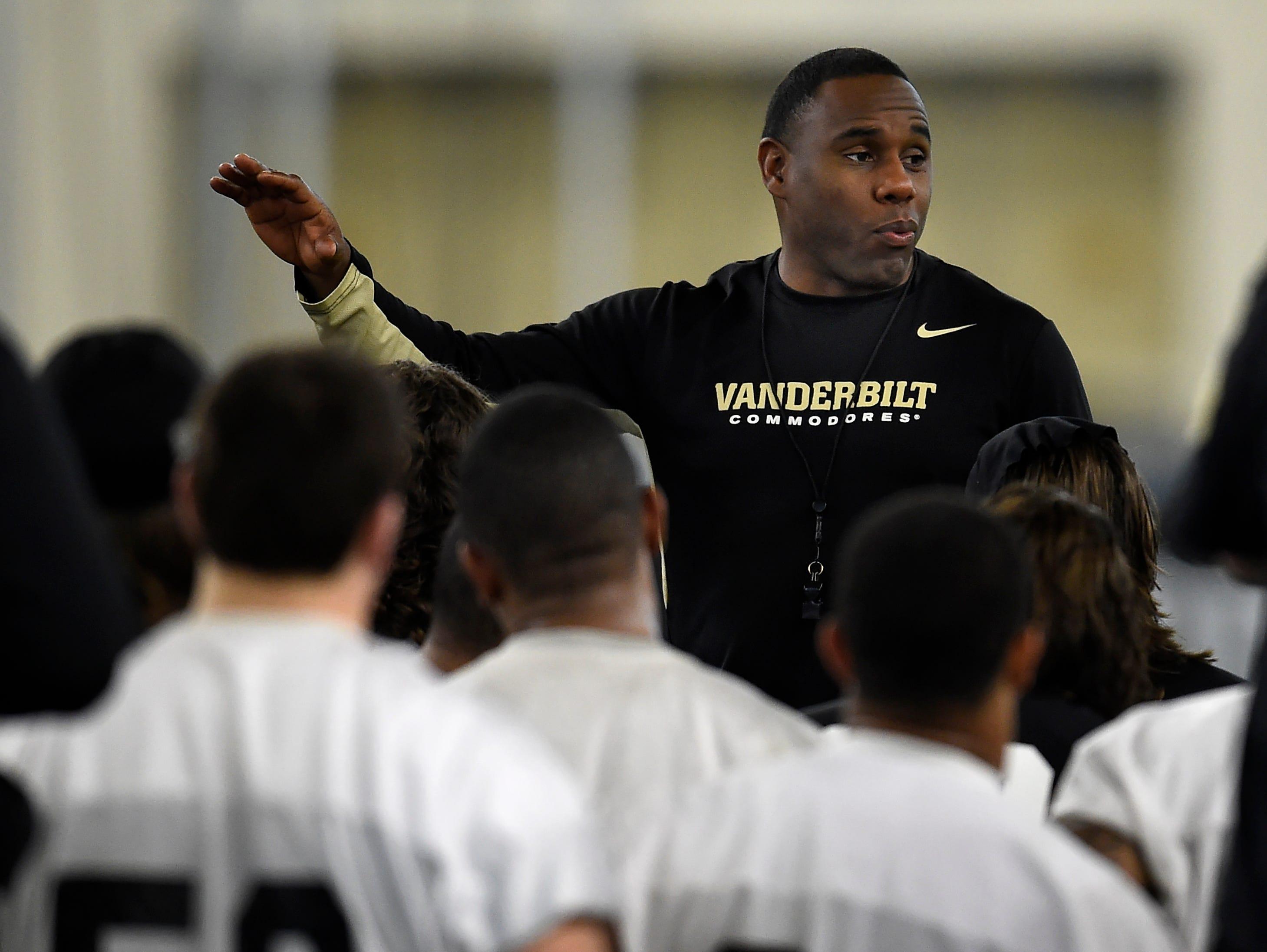 Vanderbilt coach Derek Mason talks with his players after their first spring practice Feb. 22.