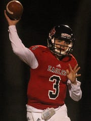 NFC quarterback Trey Fisher throws a pass during a Class 2A playoff game against St. John Paul II on Friday night.