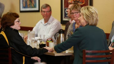 Hillary Clinton appears at the Tremont Grille in Marshalltown, Iowa, on Wednesday. (Michael Zamora, The Des Moines Register)