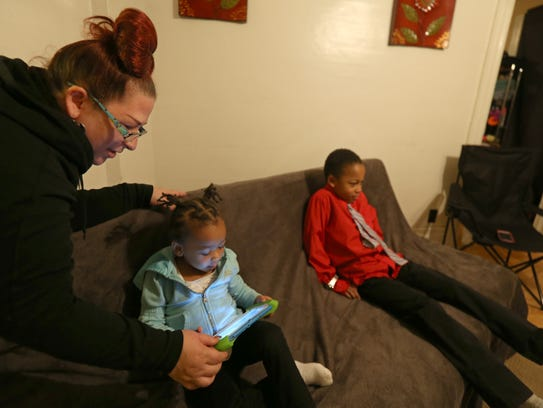 Mary Jo Newtown looks over a video game with her granddaughter