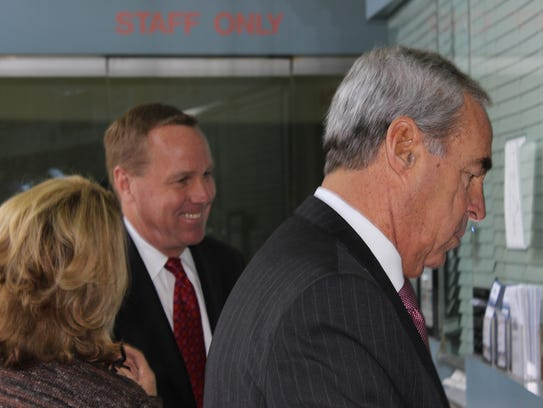 Former Palm Springs Mayor Steven Pougnet, in the background,  surrenders at the Riverside Jail on Feb. 22, 2017 alongside his criminal defense attorney, Malcolm Segal. Pougnet has used more than $46,000 in campaign funds to pay Segal.