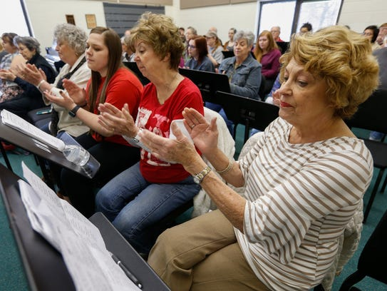 Betty Rosenberg, right, claps during rehearsal with