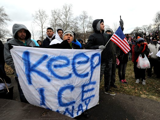 Roberto Orozco, center, 53, of Detroit, and Christian