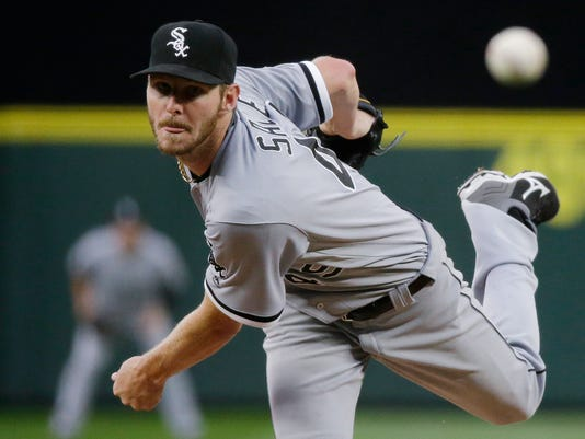 """FILE - In this Monday, July 18, 2016, file photo, Chicago White Sox starting pitcher Chris Sale throws to a Seattle Mariners batter during a baseball game in Seattle. Sale has been scratched from his start against the Detroit Tigers after he was involved in what the team says was a """"non-physical clubhouse incident."""" The White Sox declined to describe the incident, but said it's """"currently under further investigation by the club"""" and that Sale was sent home from the park. (AP Photo/Ted S. Warren, File)"""