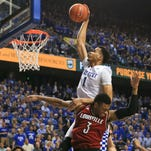 Kentucky's Skal Labissiere couldn't get the dunk over Louisville's Trey Lewis. UK beat Louisville 75-73 at Rupp Arena.