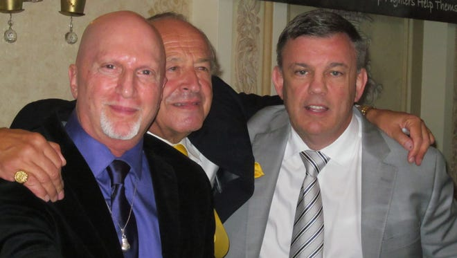 Pleasant Valley resident Ron Lipton, left, cut man Rich Schwartz, center, and former boxing trainer and current fight commentator Teddy Atlas on Sept. 13. Lipton received the 2015 Jose Torres Renaissance Boxing Award.