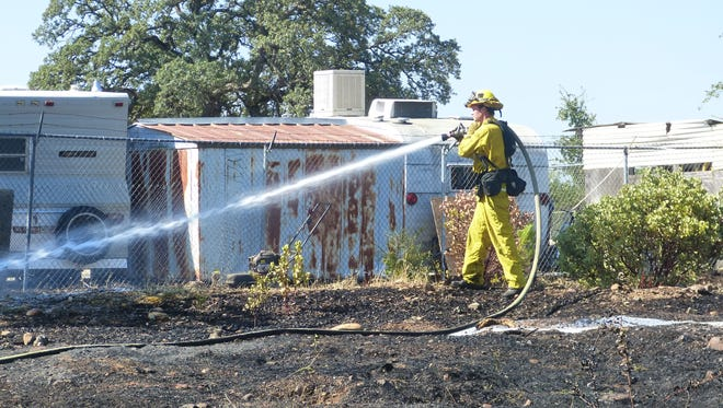 A fire that broke out Tuesday near Lake Boulevard and Hilltop Drive was put out after scorching one-acre of weeds and dead grass.