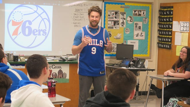 Washington Township teacher Matt Groark tells students they'll accompany him to Philadelphia 76ers game.