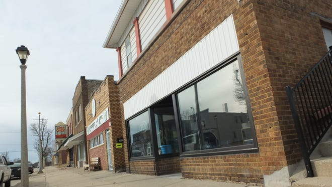 Formerly Green Flag Racing, the storefront at 1218 Milwaukee Ave., in South Milwaukee will soon be an antique store.
