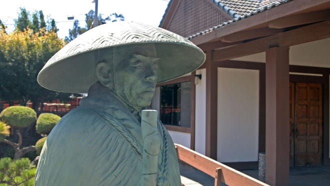 The bronze statue of Shinran Shonin with its remarkable patina.