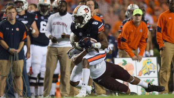 Auburn wide receiver Tony Stevens (8) is tackled by